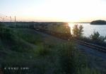 UP 7160 & 8199 Weston Coal Loads pass Lake Wissota